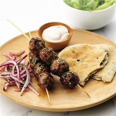 Spicy lamb kofta kebabs with houmous dressing recipe. The special ingredient in this healthy dish is the houmous in the dressing - it goes perfectly with the warming, spicy meatballs.