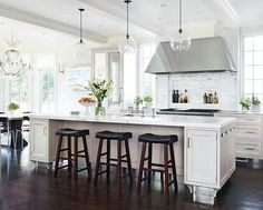 everything about this...definitely THESE lights over island!  Cabinets, floors, tile backsplash with built-in shelf, stainless hood-vent, countertops...basically this is my new kitchen!
