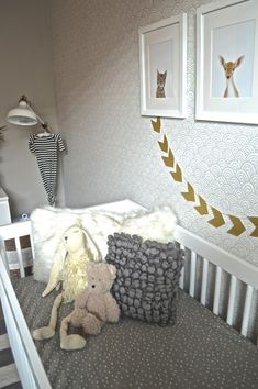 Modern Baby Boy Nursery - gray wallpaper and decor with pops of gold