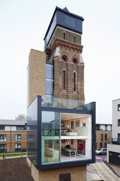 Converted water tower. Personal project of homeowners Leigh Osborne and Graham Voce. Over a period of eight months, the couple converted the remnants of the 19th-century building (which was filled with 2,000 dead pigeons when they discovered it) into their dream home, creating a modern living space with four bedrooms, a gym, a rooftop terrace, elevator, bathrooms, and gigantic windows which give stunning 360º views of London.