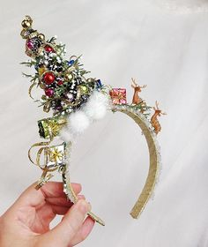 A festive forest scene headband, showcasing a decorative Christmas tree, miniature reindeer, and piles of neatly wrapped presents! MADE TO ORDER, ships in 5-7 days (or inquire for a rush order, if youre in a hurry). If you buy 3 OR MORE headbands, take 15% off your order: use coupon