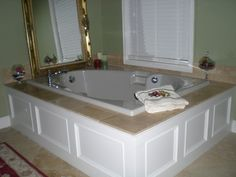 Master Bathroom Tub Panel Moulding with Travertine Tile traditional bathroom