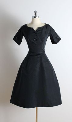 ➳ vintage 1950s dress  * black silk taffeta * silk & tulle lining * button accents * metal back zipper * by Harvey Berin  condition | excellent  fits like xs/s  length 42 bodice 16 bust 36-37 waist 26-27 bodice allowance 1 hem allowance 2.75  ➳ shop http://www.etsy.com/shop/millstreetvintage?ref=si_shop  ➳ shop policies http://www.etsy.com/shop/millstreetvintage/policy  twitter | MillStVintage facebook | millstreetvintage instagram | millstreetvintage  5737/1619