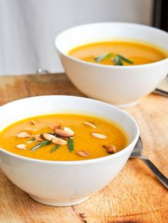 Simple and delicious vegan creamy pumpkin soup recipe served sprinkled with toasted almonds and fresh rosemary. Ready in under 30 mins. Gluten free too!