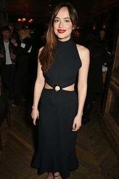 Check out those abs! Dakota's LBD was given an exciting edge with the cut-out detailing.