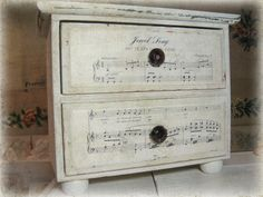 Cute drawer remake for the creative space using vintage music-