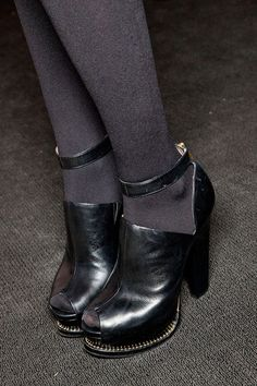 DKNY, Fall 2012 ------------ I like these but want the toes to be closed. Love the pewter leather with grey tights!