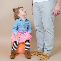 A denim shirt with a pink frilly skirt, fun striped legging paired with the Double Fringe Boot makes for a fun outfit for you little one on the go.