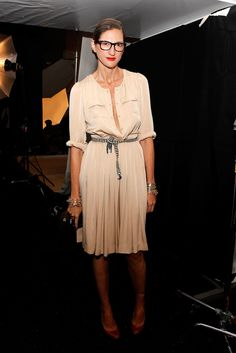 Jenna Lyons went feminine in a peach-hued, pleated dress.
