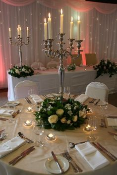 Candelabra centerpiece for tall table decorations Candelabra Wedding Centerpieces, Wedding Table Centerpieces, Candelabra Flowers, Flower Centrepieces, Flower Decorations, Wedding Decorations, Wedding Ideas, Winter Wedding Flowers, Candle Stand