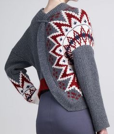 jean paul gaultier sunburst asymmetrical sweater. Interesting use of color around the arm instead of the neck.