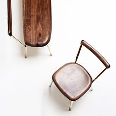 German designer Valentin Loellmann has created a collection of tables and chairs that pair rounded plates of polished brass with wood.