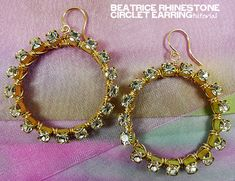 rhinestone chain wrapped on brass circles. Instructables tutorial also at: http://www.instructables.com/id/Beatrice-Rhinestone-Circlet-Earring/