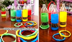 Oi gente!     Esta é uma sugestão para fazer um jogo de argolas usando garrafa pet e tiras de jornal. O jogo ficar super colorido e lindo, ...