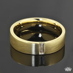 Men deserve diamond too - This handsome Custom Diamond Wedding Ring is set in 18k yellow gold and features a spin satin finish on the comfort fit band. A 0.18ct baguette finishes off this dapper look.