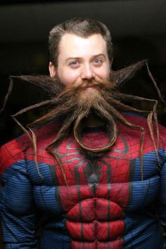 An IT administrator has sculpted his facial hair into the Spider-Man logo. Chad Roberts' spider beard  won Best in Show at the second annual Garden State Beard and 'Stache competition in New Jersey. Chad styles his beard with extra strength hairspray and says too many gels and waxes can weigh it down. Currently his beard measures just over 35 centimetres (14inches) long.