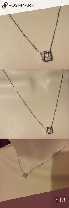 925 Sterling Silver Magic Cube Diamond Necklace Magic cube pendant statement Necklace Cube with a floating diamond cubic zirconia n 925 Sterling silver High polish finish 16in Chain  Brand new with tags  What u see is what u get Same or next day shipping Bundle n save Follow n share Thanks so much Check back soon for more great deals on makeup skincare Chokers corsets waist Cincher Jewelry clothes n more. Jewelry Necklaces