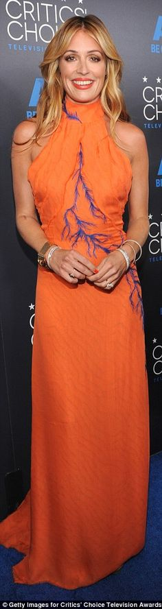 Hostess with the most: The night's host Cat Deeley was a style standout in a orange halter...
