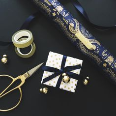 : two turtle doves : Rich indigo and gold in our Two Turtle Doves wrap. Match with indigo satin ribbon, pebble gold belli band and gold glitter tape for added sparkle