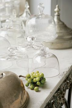 Glass cloches and silver on a French pastry table