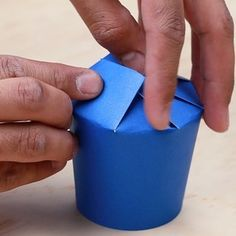 Fold the last flap under your first flap to complete the spiral. | This Paper Cup Gift Box Will Save Your Christmas Presents And Your Wallet