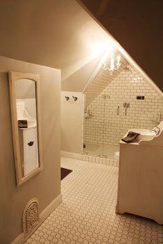 Bathroom Upstairs: Reid and Caroline bath with angles where sauna is? The Farmhouse - Magnolia Homes