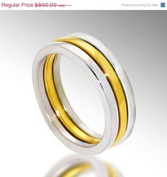 Three stackable wedding rings in yellow and white gold by Arosha Taglia
