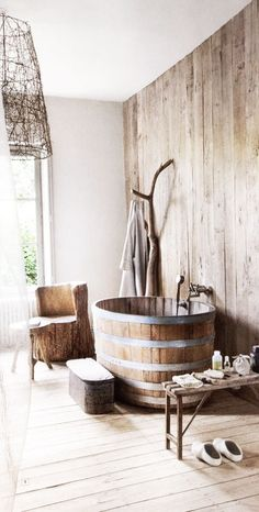 wine barrel tub, natural carved chair, branch for holding robes and the natural branch light shade.....