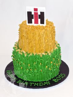 Farmer's birthday cake with tiers of wheat and corn and International Harvester (IH) tractor logo