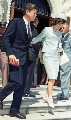 President John Kennedy and the First Lady, leave Mass.