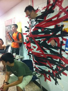 Best charity idea ever. One dollar per duct tape piece. (He's the Principal)