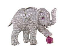 Platinum diamond & ruby elephant brooch.