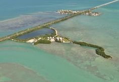 Own your own Florida Key!  Rare Opportunity /Walkers Island 13 cottages and two luxury houses on private Island with US1 access. 300' Dockage, 6 vacant lots for future development. Cottages built in the '40s/, Two Balinese inspired Luxury homes, built '10, have over 4152 sq. ft. w/marble, granite and tropical hardwood finishing materials. Top Line stainless appliances. 15 min to Airport shopping, dining, shopping and all amenities.  Offered by American Caribbean Real Estate Middle Keys