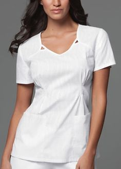 Style Code: This V-neck top features a cut-out detail at the front neckline, release tucks at the waist, bust darts, and back darts for a flattering fit. Patch pockets and side vents complete this picture. Scrubs Outfit, Scrubs Uniform, Spa Uniform, White Scrubs, Medical Scrubs, Nursing Scrubs, Cherokee Scrubs, Uniform Design, Scrub Pants