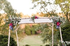 White Birch Chuppah from Annie's Creek | Photo by Amber Kay Photography | Colorful Historic Mansion Wedding on heartlovealways.com