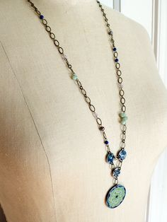 vintage tin necklace - double play. $49.00, via Etsy.