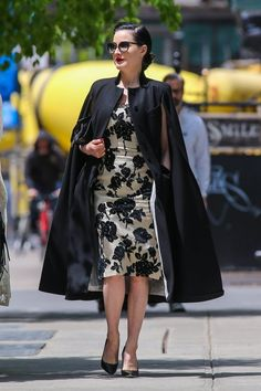 Dita Von Teese always looks chic | wearing a black cape and floral dress in NYC