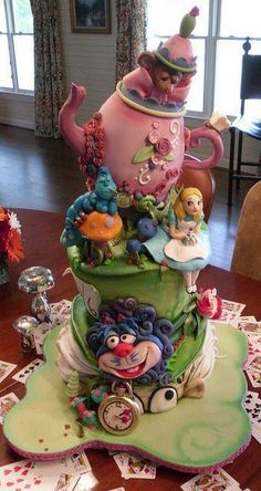 I think it'd be fun to do an Alice in Wonderland cake. Obviously, not as extravagant as this, but we can use fondant, cake paints, and cake pops