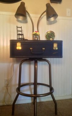 Vintage suitcase nightstand made from reclaimed barstool. #reclaimedaustin