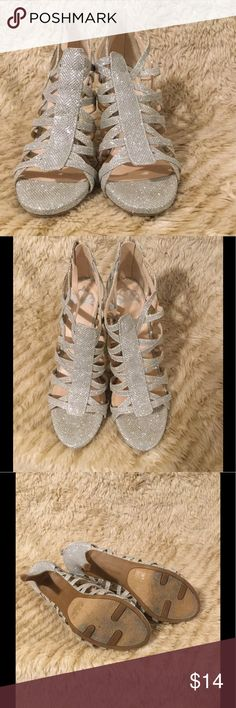 Strappy Silver Heels Gorgeous strappy heels. Goes great with a formal wear but could also dress up some jeans. Shoes are comfortable. Worn once for a wedding. Fergalicious Shoes Heels