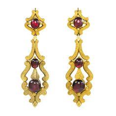 -Antique English Garnet Earrings in engraved gold arabesque frames, in 15k. England. ca. 1820