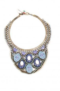 Collier Sveva Brigitte Bardot. Necklace made of stones, lace and braided metal, bronze, violet, blue, light blue and white colors. Hypoallergenic metal. Made in Italy. Sveva Spring Summer 2013 Collection. Circumference: 45 cm. Height: 25 cm.