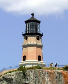 lighthouses pictures | few tourists enjoying the Split Rock Lighthouse.
