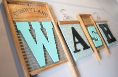 laundry room wall decor made from old wash boards and hangers. www.adiamondinthestuff.com