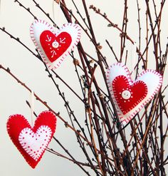 This listing is for not one but THREE felt heart ornaments!!! My embroidered heart ornaments are cute decorations and also make fun valentine gifts! I love mine so much, they are hanging in my craft space all year long! As I am a valentines day baby, I also picture these lovely hearts in a nursery. Or just a special gift for your sweetheart! The possibilities are endless! Have fun with these!! ********************  I have other colors available as well. Please choose your color at check out…
