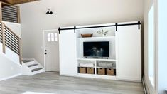 """Free step-by-step plans to build your own barn door entertainment center. Measures 11 feet long by 7 feet tall and about 18"""" deep. Save thousands and get exactly what you want by doing it yourself. Free plans by Ana-White.com. #anawhite #anawhiteplans #diy #diyfurniture #entertainmentcenter #barndoor #farmhouse #farmhousedecor Building A Barn Door, Diy Barn Door, Diy Furniture Plans, Farmhouse Furniture, Hanging Barn Doors, Anna White, Do It Yourself Decorating, Diy Countertops, Diy Entertainment Center"""