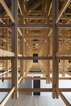 View through lattice roof space with thin horizontal and vertical timbers-KYUDO ARCHERY HALL BY FT ARCHITECTS