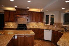 Cherry Cabinets With Granite Countertops | Home D - Elegant Tile Backsplash