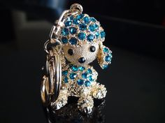 Hey, I found this really awesome Etsy listing at https://www.etsy.com/listing/229829905/cute-gold-poodle-crystal-keychain-blue