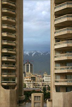 Alborz mountains seen through Eskan towers in Tehran, Iran